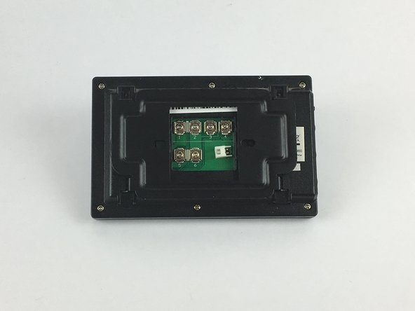 Flip the monitor of the Swann Doorphone over so that the underside is facing up.