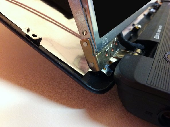 Take the LCD screen out of the metal frame and flip it towards the keyboard.