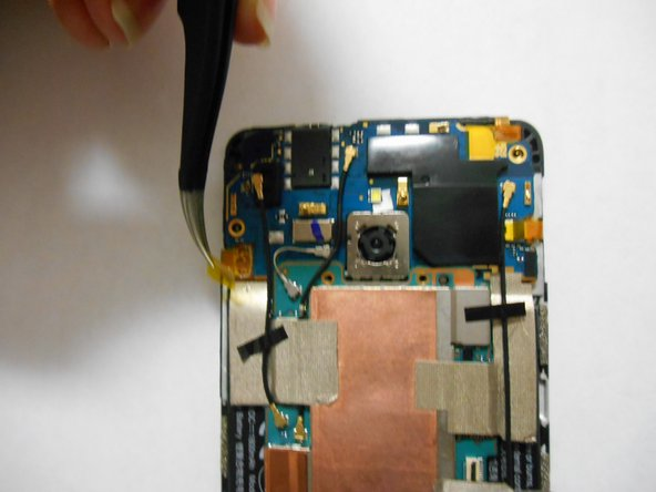 Use tweezers to remove the yellow tape covering the flex cable connectors (total of five).