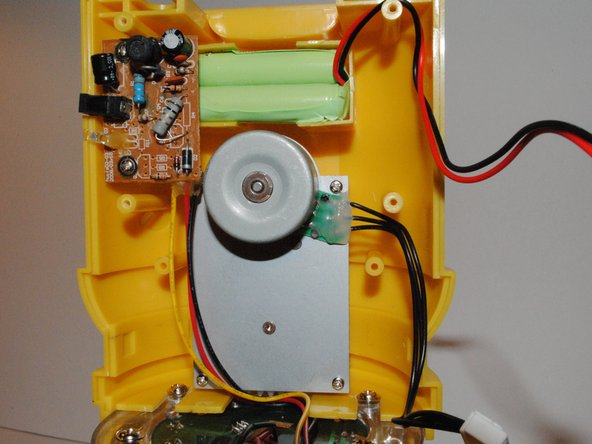 Insert new battery into the housing of the old battery with wires facing away from the DC-in board.