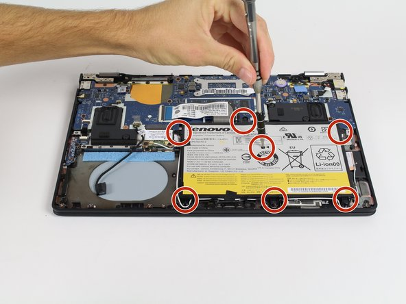 Using a #00 Philips Precision Screwdriver, remove the seven 3.175mm screws that hold the battery in place (six on the outside, one in the middle).