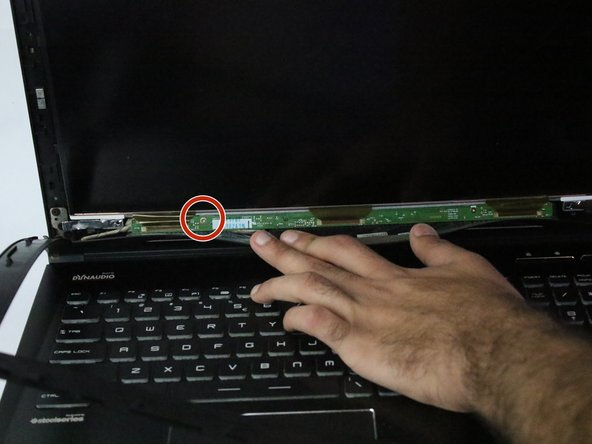 Remove the two screws located at the bottom of the screen using the PH1 screwdriver.