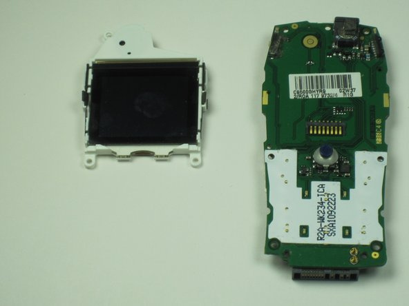 Carefully remove the plastic clips holding the screen on the board.