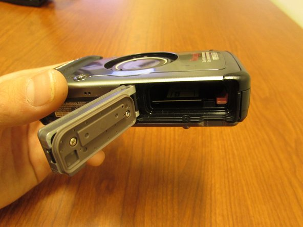 Image 1/1: Batteries contain highly acidic contents. If yours has leaked or ruptured while inside the compartment, there may be damage to the cameras circuitry. Clean out any residue using latex gloves and  tissues.