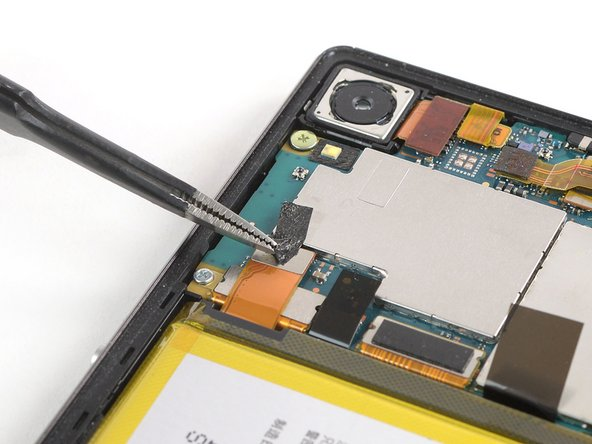 Use a pair of tweezers to peel the black adhesive strip off the battery connector and fold it out of the way.
