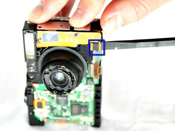 Carefully disconnect the flash assembly ribbon from the black connector lock using the spudger.