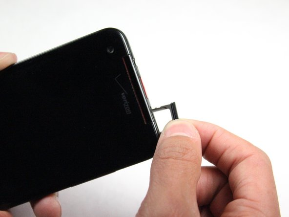 Pull out the SIM Card Tray with your fingers.