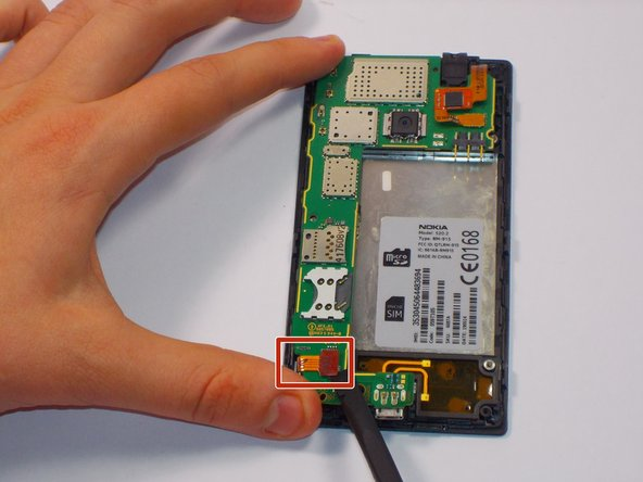 Carefully unclip the digitizer touch screen cable and the display screen cable using the spudger.