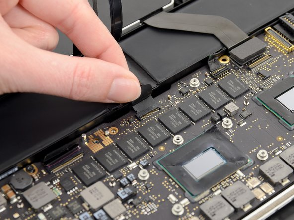 Repeat the previous procedure to disconnect the Trackpad ribbon cable from its socket on the logic board.