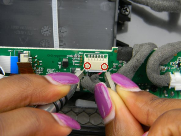 Use the 0.8 and 1.0 screwdriver tips to press on the pins to release this cable.