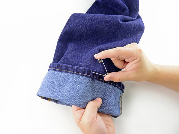 Image 3/3: Unpin the cuff of the jeans.