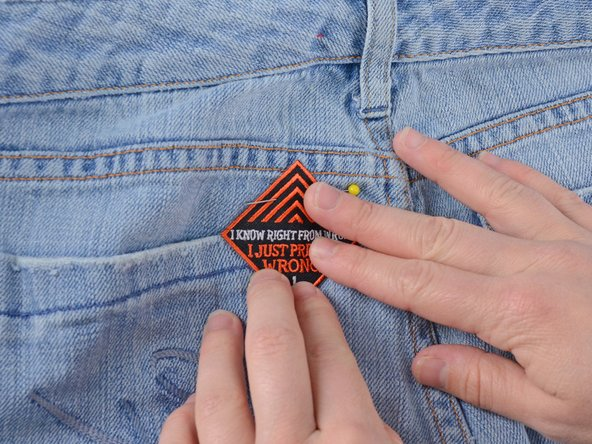 Be sure to only pin the patch to one layer of denim, or you will sew the pants shut.