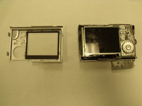Using fingers, pull the back silver faceplate to separate it from the rest of the camera.