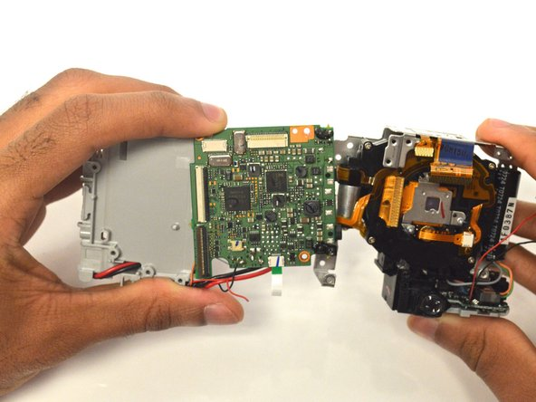 Separate the lens from the motherboard and put the lens housing unit aside for later use.
