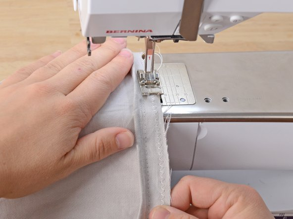 Sew around the hem, as close to the edge as possible.