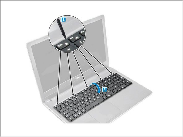 Release the keyboard by prying on the keyboard release tabs using a plastic scribe [1].