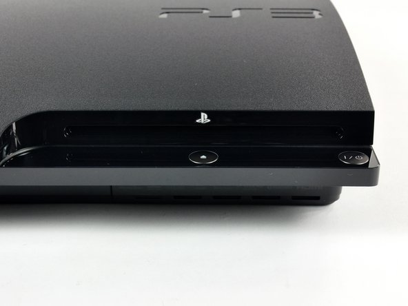 Front right yields a slot-loading Blu-ray drive, power button, and eject button.