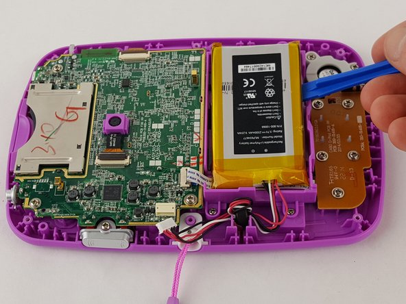 Pry the battery gently off of the plastic platform with an opening tool.
