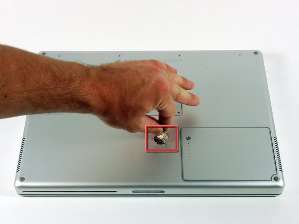 Image 1/1: Lift the battery out of the computer.