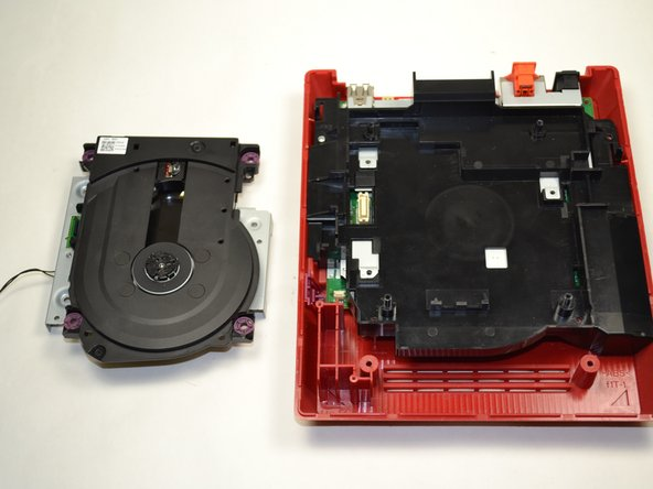 Lift the disc drive out of the console and set it aside.