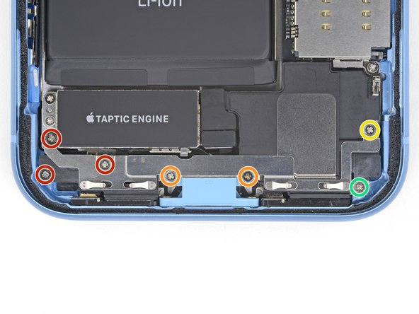 Remove the seven screws securing the bracket below the Taptic engine and speaker: