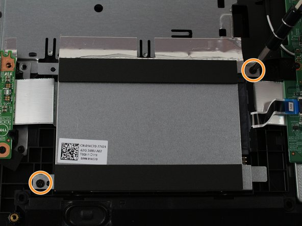 Remove the 0.5 mm Phillips screws that secure the hard drive to the palm-rest.