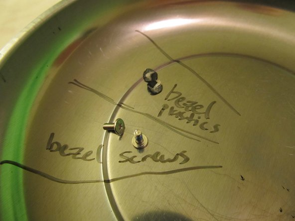 As my tutorials will always instruct, keep track of your screws with a dry erase marker on your magnet bowl.