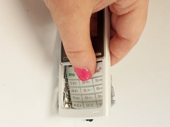 To remove the keypad, apply pressure from the front of the case.  It will come out easily.