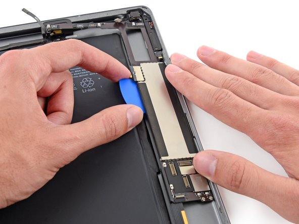 Once the adhesive has been cut, pry the battery side of the logic board upward off of the rear case.