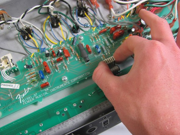 "Caution! While working in the amp head, use only one hand to ensure safety from electrical shock. This is a rare occurrence but only using one hand will protect you. Do not ""ground"" yourself by touching anything else with your other hand. Do not touch any unfamiliar components."