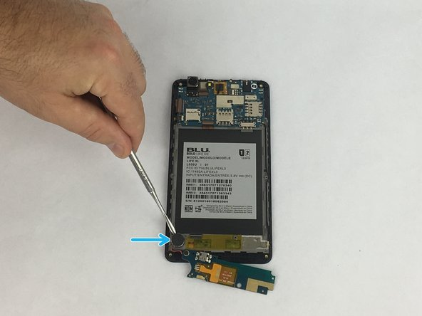 Remove haptic motor at bottom left of the device. This will require a prying tool, as the motor is glued to the device.