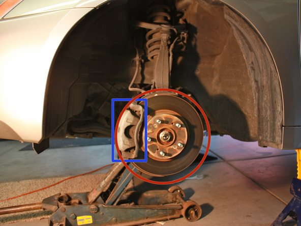 This exposes the caliper (shown in rectangle) and rotor (shown in circle).