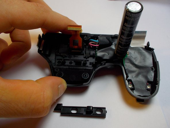 Remove the rectangular plastic piece.