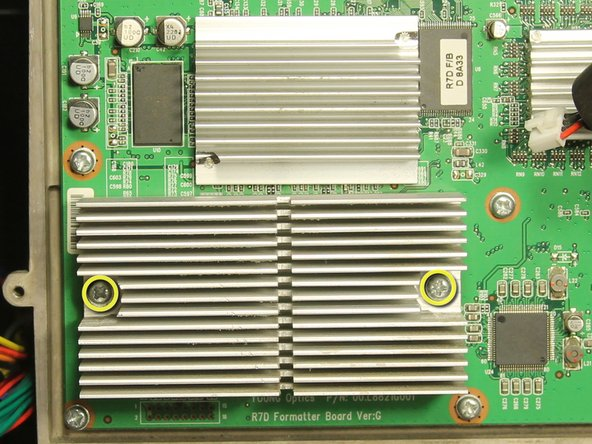 Remove the two 15 mm Phillips #0 screws holding the DLP heat sink to the light engine board.