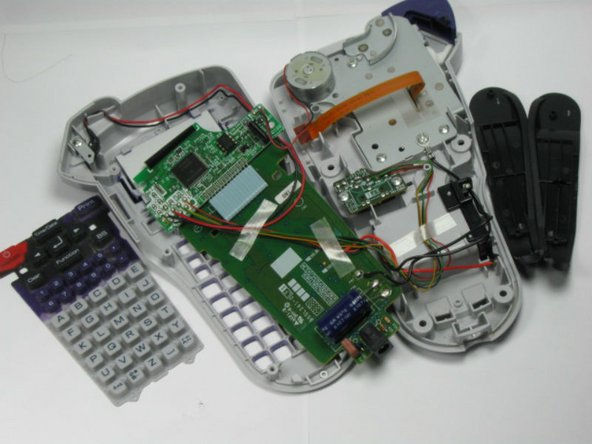 Underneath the circuit board you will find the rubber keyboard. Peel this off and remove it from the device.