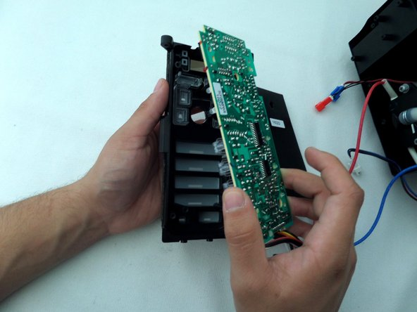 Carefully remove the control panel from the control module.