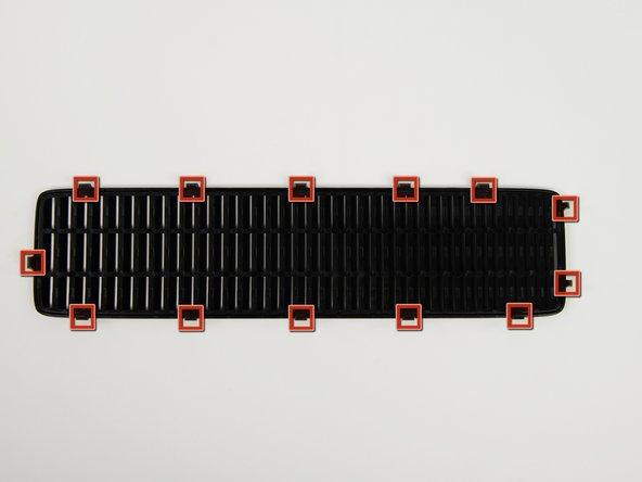 In the following steps, you will remove the top vent, secured to the top panel by the thirteen clips shown.