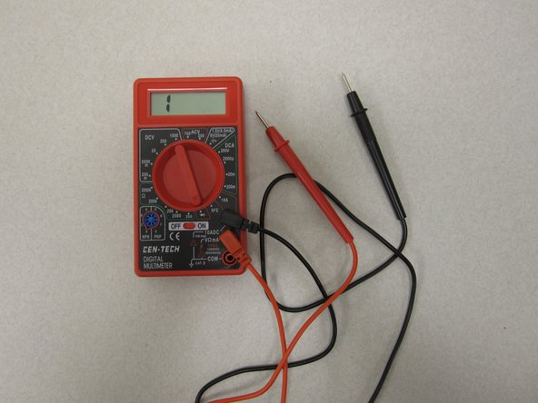 Image 1/2: Turn the dial on the multimeter to continuity test mode.