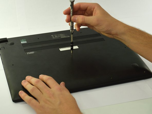 Turn laptop over and unscrew the eleven M2 x 6.0mm back cover screws with the Phillips #0 screwdriver.