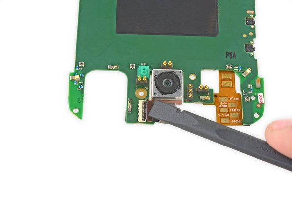 Use the flat end of a spudger to flip up the black retaining flap on the front-facing camera ZIF connector.