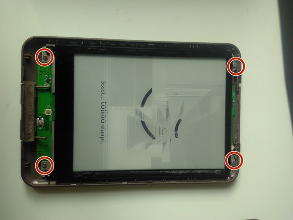 Remove the back cover by unscrewing the 4 screws indicated in red
