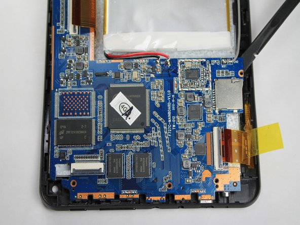 Image 2/3: The battery is still attached to the logic board. Be careful to not tear the two apart during removal.