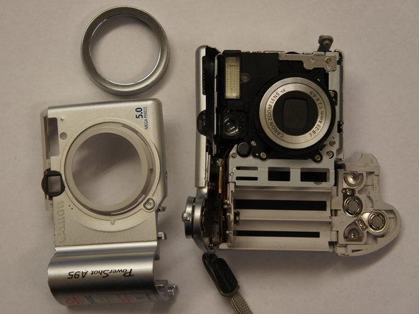 Separate the back casing from the front casing of the camera.