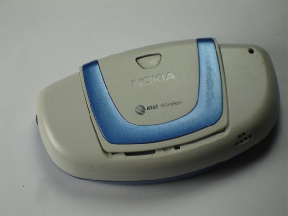 Flip the Nokia 3300B over with the back-side facing towards you.