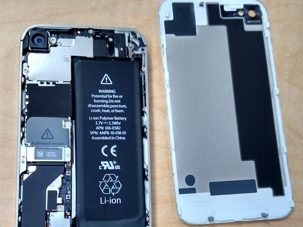 Carefully pull the rear panel away from the iPhone. Be careful not to break the clips that attach it to the phone.