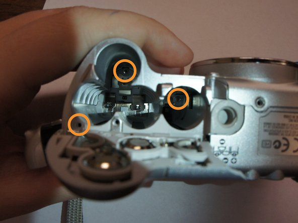 Re-open the battery cover. Locate and remove the three screws under the battery cover (3x small, long Phillips head).