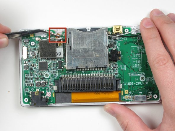 Locate the small ribbon cable that connects the touch screen to the logic board.