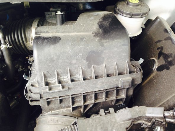 As you are facing the Civic, the air filter will be inside the black plastic box to the right of the valve cover.