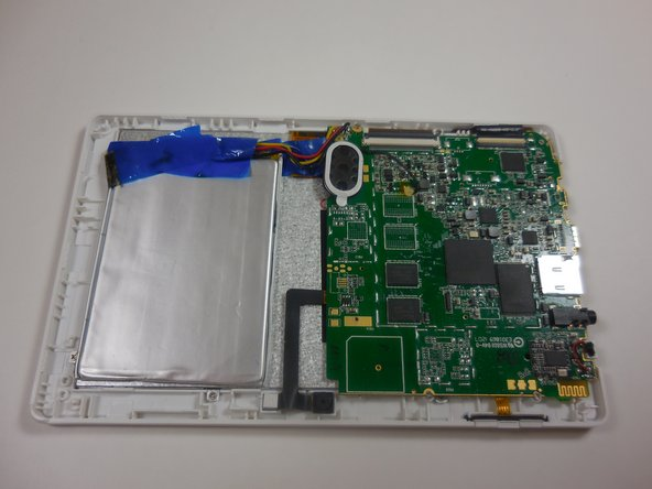 Image 1/3: Remove the motherboard by unscrewing the four 4 mm screws along the edges of the board using a Philips 00 screwdriver.