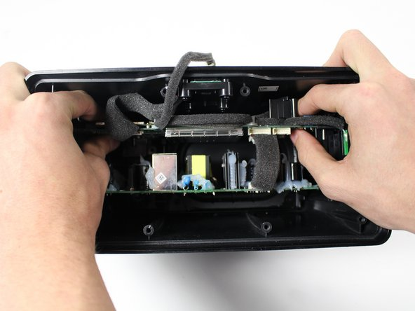 Gently remove the motherboard from the Sonos device by sliding it straight back towards you.